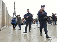 France Vows Merciless Response After Attacks Kill 129