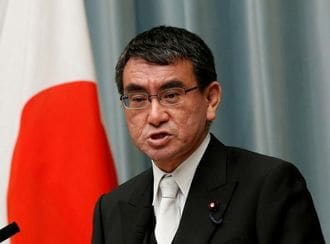 Japan urges pressure on N.Korea, military to seek record defence spending