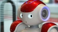 Robot Bank Clerk Greets and Helps People at Narita Airport