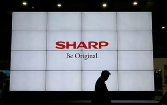 Sharp makes long-awaited OLED foray, wary of big spending