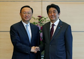Japan PM says he wants to work with China to resolve North Korea crisis